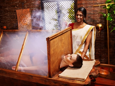 window treatments: Woman having Ayurvedic sauna treatment.