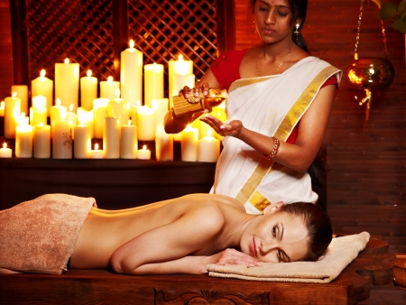 Young woman having oil Ayurveda spa treatment. Stock Photo - 18940537