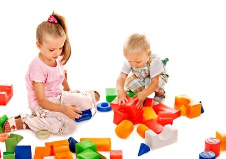 play blocks: Happy children playing building blocks. Isolated.