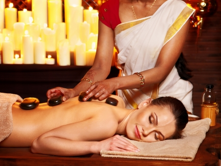 ayurveda: Young woman having Ayurveda stone massage.