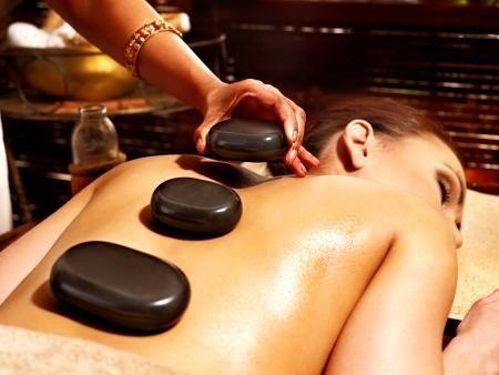 panchakarma: Young woman having Ayurveda stone massage.