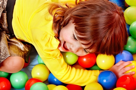 playcentre: Little girl  in group colourful ball.