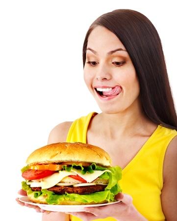 lengua afuera: Mujer la celebraci?e la hamburguesa. Aislado.