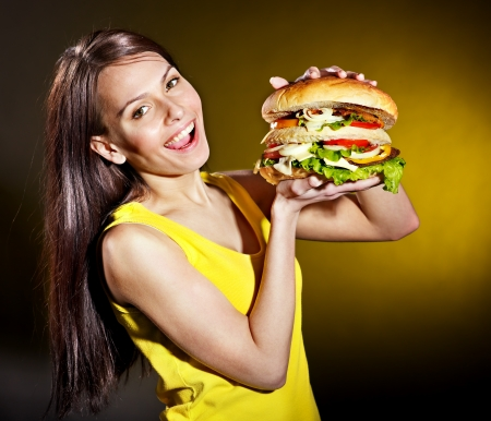 Slim woman holding hamburger. Stock Photo - 19555467