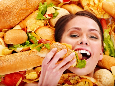 Thin woman holding hamburger. Stock Photo - 19557887