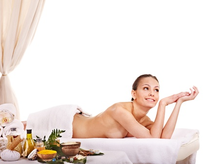 massage herbal: Young woman getting spa treatment . Isolated. Stock Photo