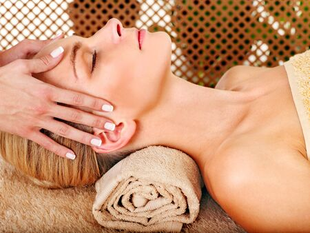 parlour: Woman getting facial massage in tropical beauty spa. Stock Photo