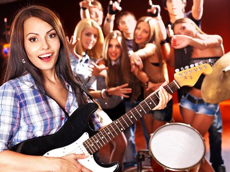 bass guitar women: Musical group playing in night club. Male and female. Stock Photo