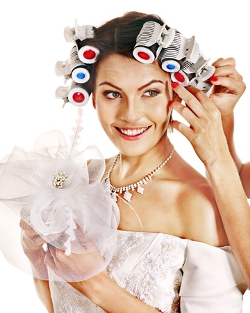 head wear: Donna con i bigodini in testa indossare in abito da sposa