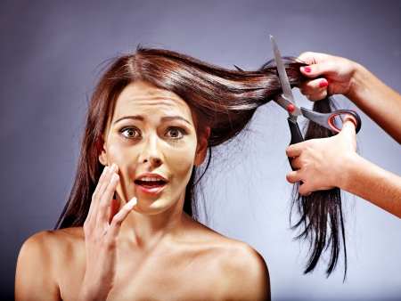 haircutter: Woman worried her hair need to cut Stock Photo