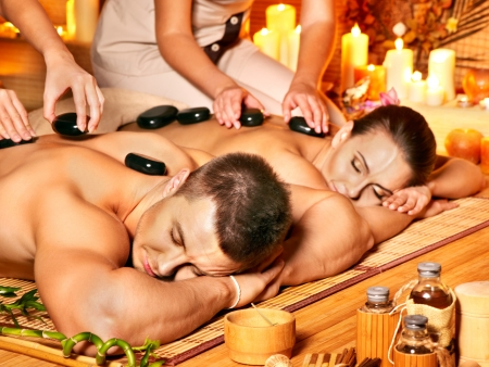 bamboo therapy: Man and woman relaxing in bamboo spa. Stock Photo