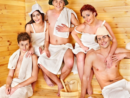Group people relaxing at sauna. photo