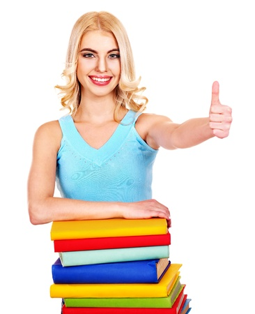 Student with stack book showing thumb up. Isolated. photo