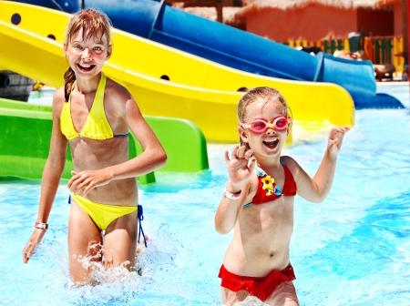 aqua park: Children on water slide at aquapark. Summer holiday. Stock Photo