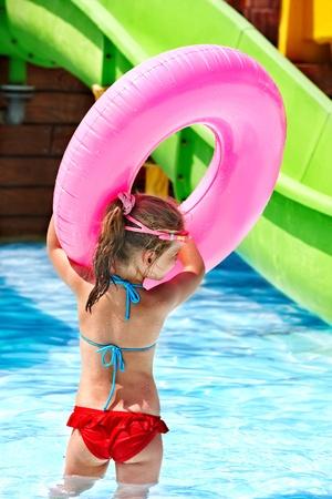 aquapark: Little girl sitting on inflatable ring. Stock Photo