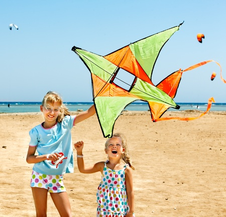 Child flying kite beach outdoor. photo