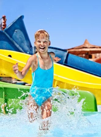aquapark: Children on water slide at aquapark. Summer holiday. Stock Photo