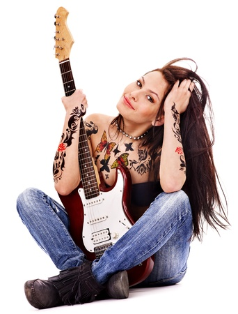 bodyart: Young woman with tattoo playing guitar. Stock Photo