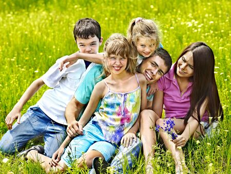 Happy family on green grass.Outdoor. Stock Photo - 20654613