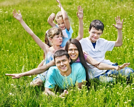 Happy family on green grass. Outdoor. Stock Photo - 20654360