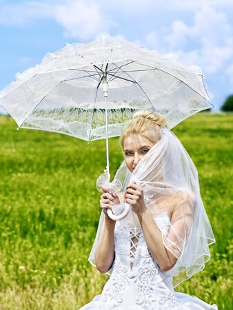 Bride in dress with parasol. Wedding  outdoor. photo