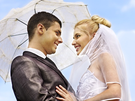 Happy bride and groom wedding summer outdoor. photo