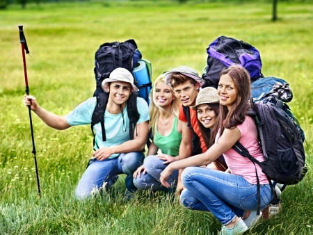 student travel: Group people with backpack  summer outdoor.