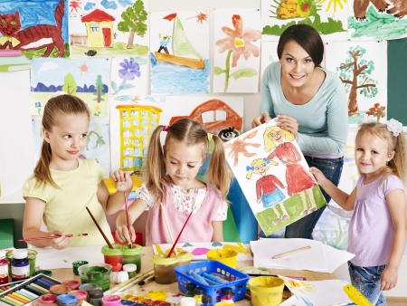 preschool children: Happy children  with teacher at school.