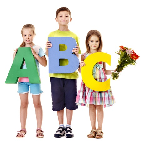 Children holding abc. Isolated. photo