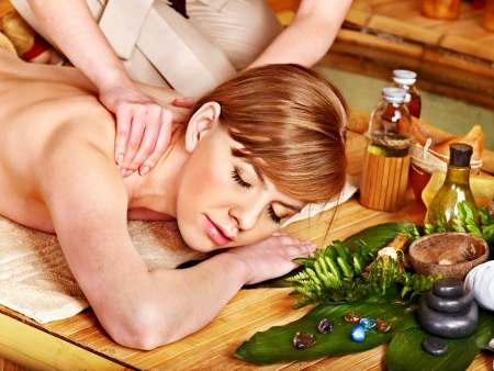 aromatherapy oils: Blond woman getting aroma massage in spa. Stock Photo