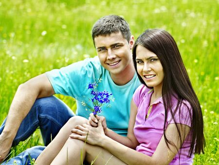Happy couple on green grass.Outdoor. photo