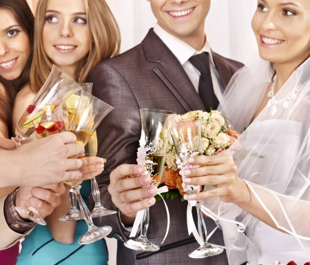 Hand holding wedding glass with champagne. Stock Photo - 20724404