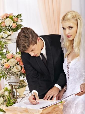 registration: Groom and bride register marriage. Wedding. Stock Photo
