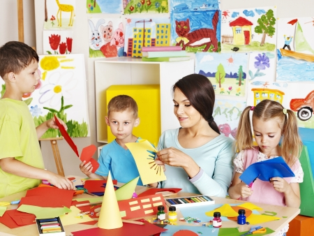 preschool children: Happy children  with scissors at classroom. Stock Photo