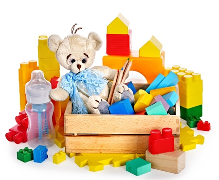 playthings: Children toys with teddy bear and cubes. Isolated.