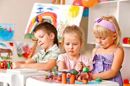 Group of children  in preschool thumb up. Stock Photo