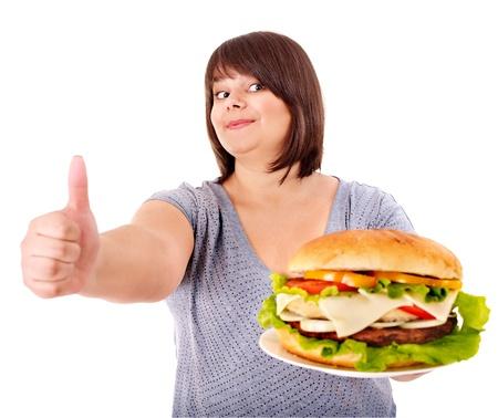 big women: Overweight woman eating hamburger. Isolated.
