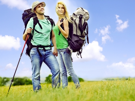 student travel: Couple with backpack  summer outdoor. Stock Photo