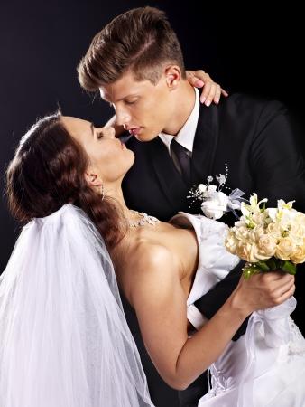 Groom kissing bride . Wedding.
