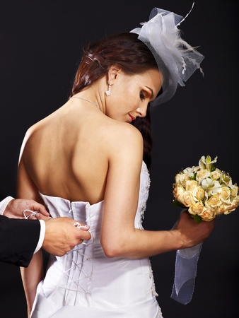 Beautiful bridal trying on wedding dress. photo