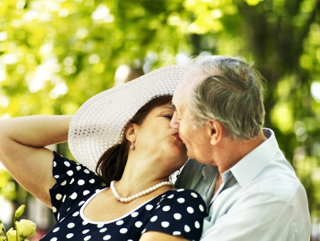 Happy old couple with flower outdoor. Stock Photo