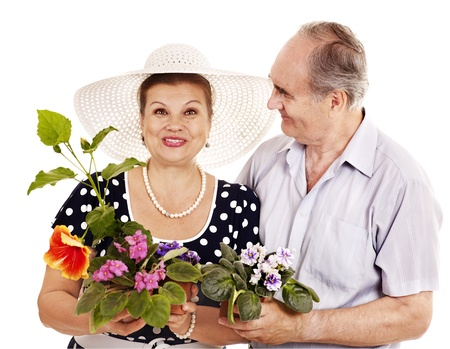 Old couple holding flower. Isolated. photo