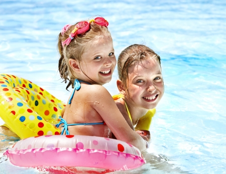 aqua park: Child with armbands in swimming pool.
