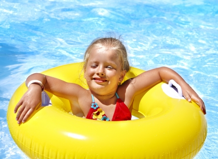 Child  on inflatable ring in swimming pool. photo