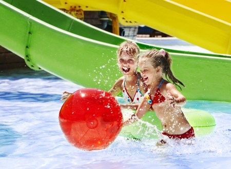 water   slide: Child on water slide at aquapark. Summer holiday.