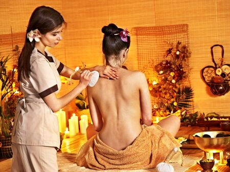 herbal massage ball: Young woman getting thai herbal massage ball.