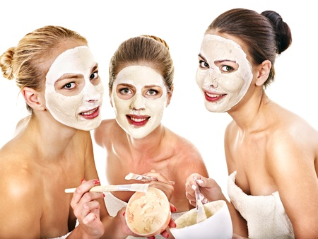 Group woman getting facial mask and gossip . Isolated. photo