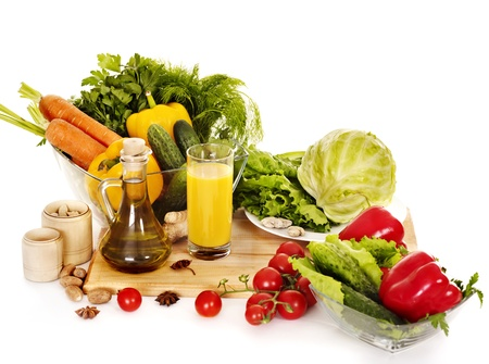 cutting vegetables: Fresh vegetable and olive oil. Still life. Stock Photo