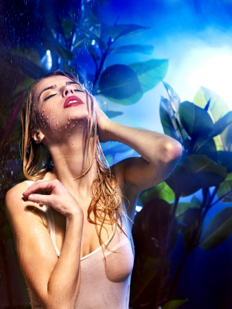 wetting: Wet woman with water drop. Nature.