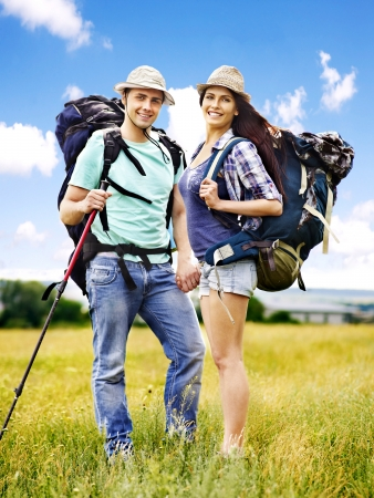 Couple with backpack  summer outdoor. Stock Photo